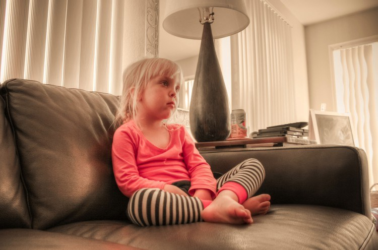 Image of little girl watching TV.