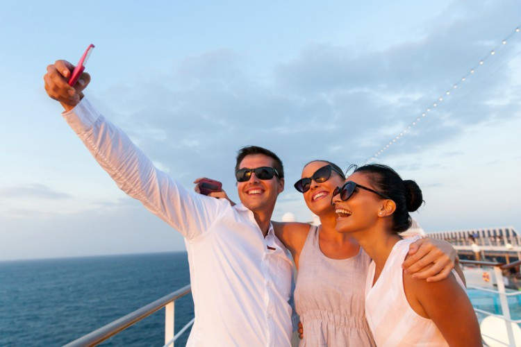 Image of people taking a selfie on a cruise ship