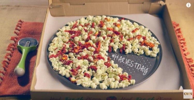 Pizza-flavored popcorn in a pizza box.