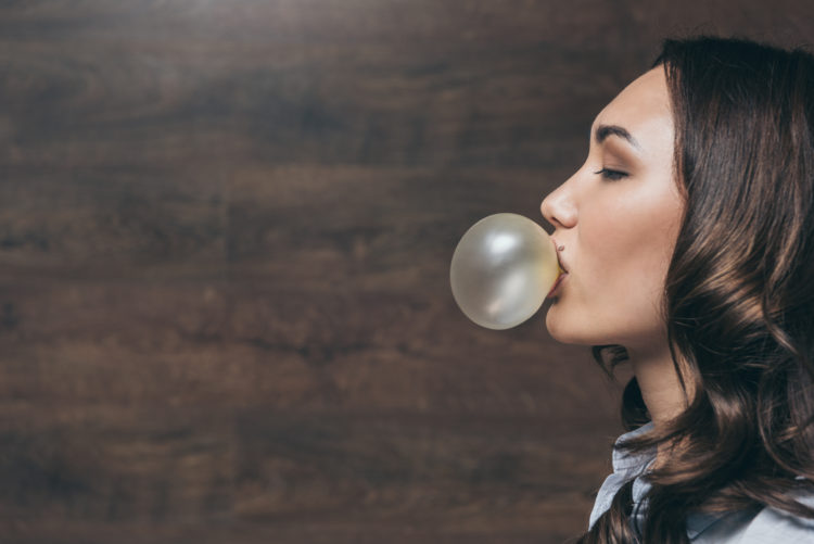 Image of woman blowing a bubble