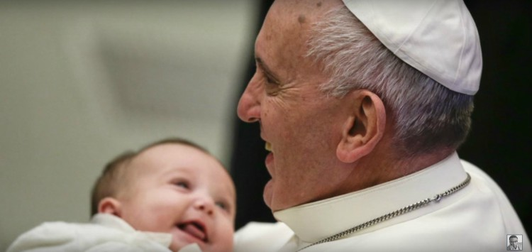 Image of Pope Francis with baby.