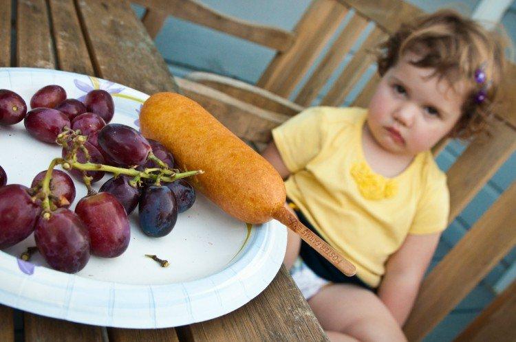 Girl avoiding her food