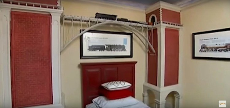 Image of kid's bedroom with train.