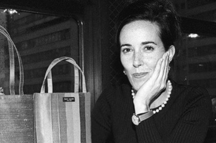 Kate Spade poses with bag