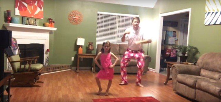 Image of dad and daughter dancing.