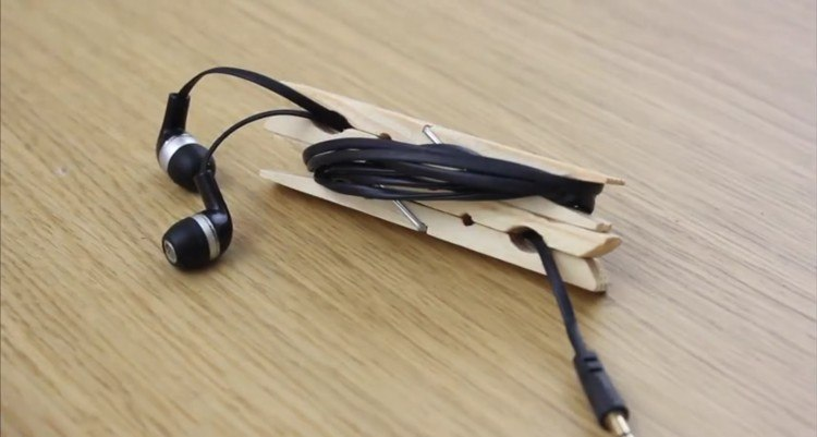 Holder for your earbuds in a clothespin.