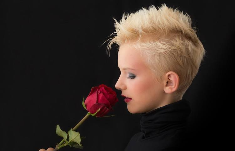 Image of short hair woman with rose.