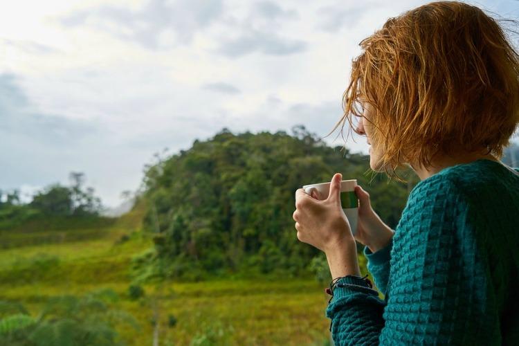 Woman drinking outside.