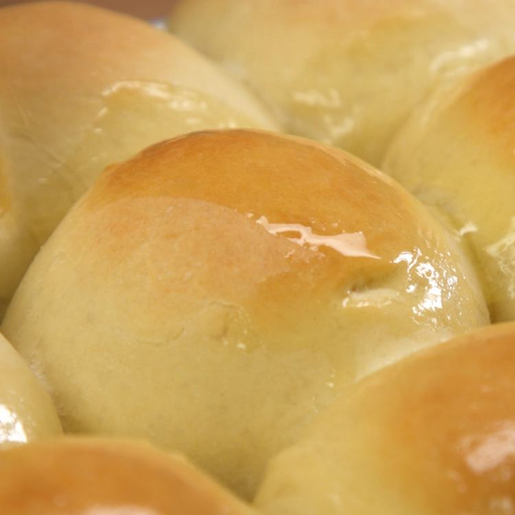 Remove from oven and brush tops with melted butter.