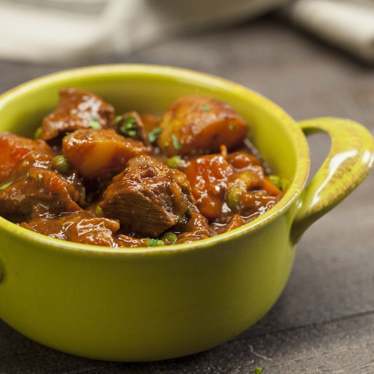 guinness beef stew in green pot