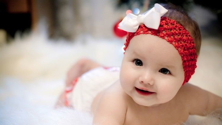 Baby with bow on its head