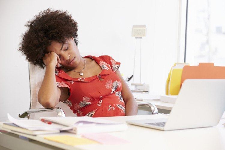Tired Woman Working At Desk In Design Studio