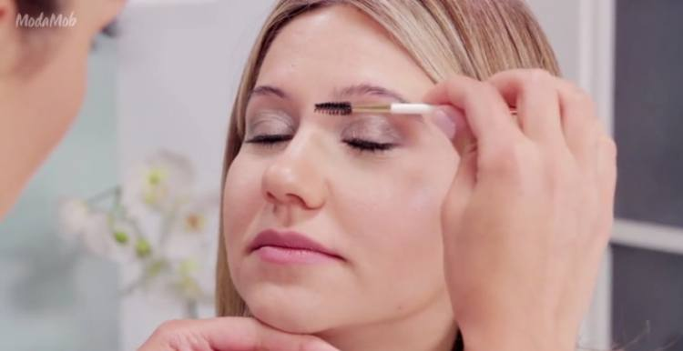 Brush eyebrow hairs up to reveal natural brow line