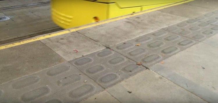 Image of tactile paving near tram.
