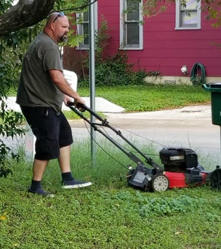 Image of ex-husband mowing ex-wife's lawn
