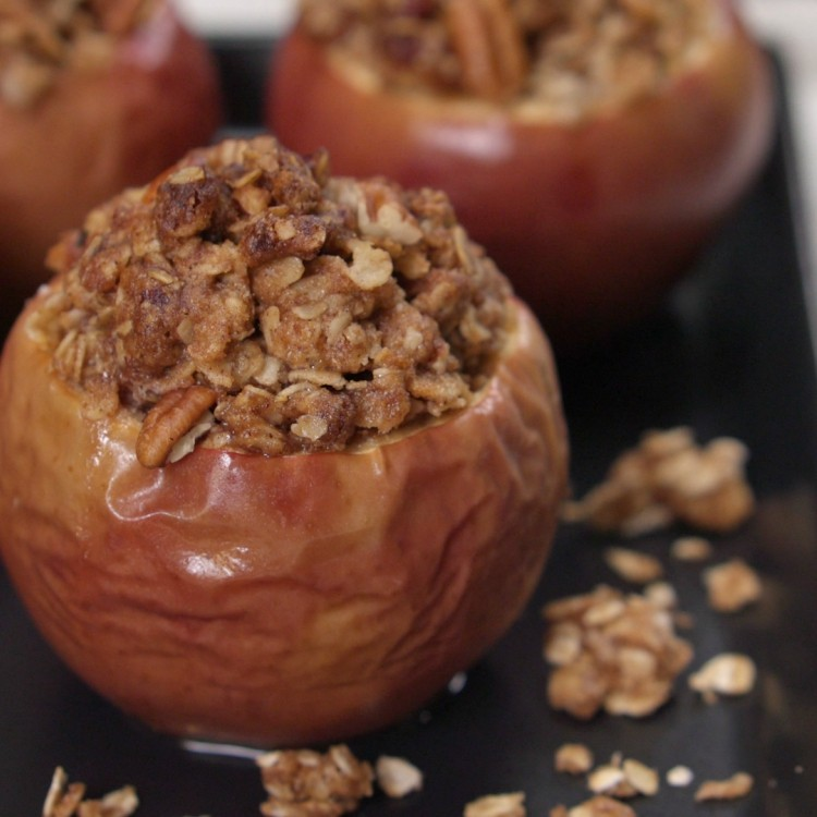 Apple crisp baked inside apple and topped with pecan crumble
