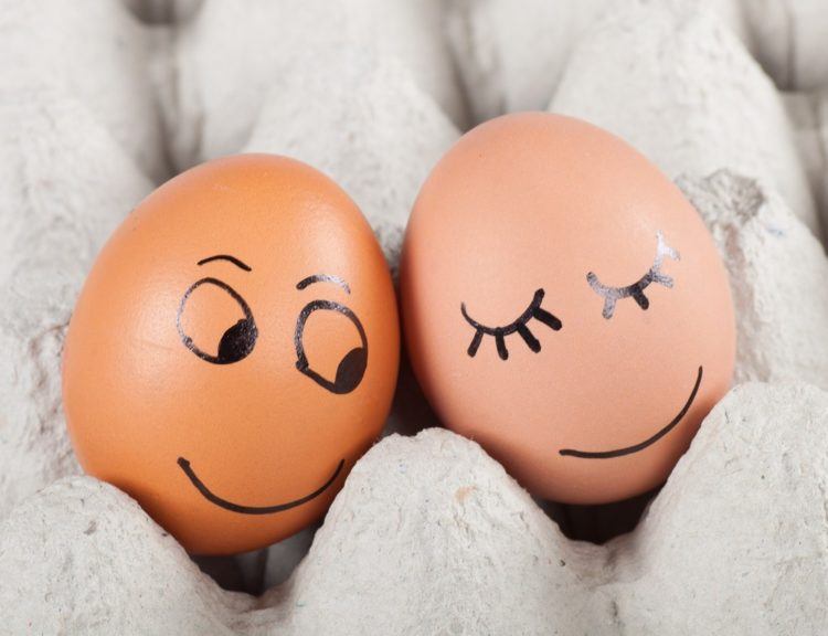 two eggs with faces painted on