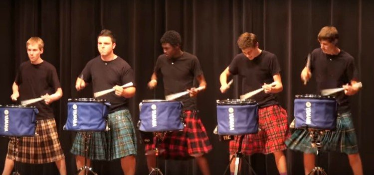 Image of guys playing drums in kilts.