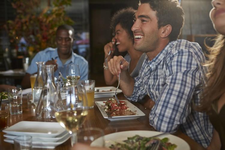Image of man eating at restaurant