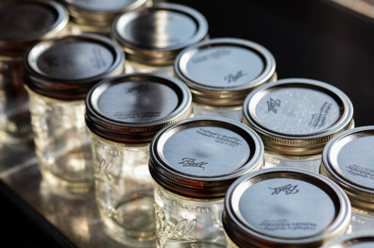 Close-up of rows of mason jars