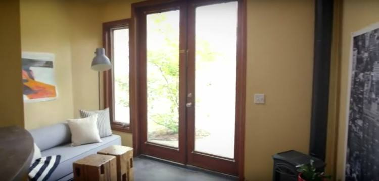 Image of glass entry doors to tiny garage house