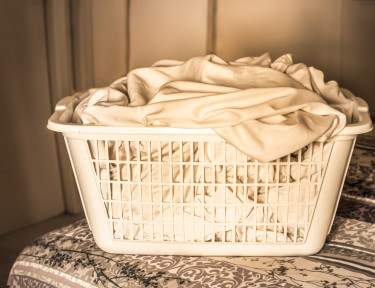 Basket of dirty sheets.