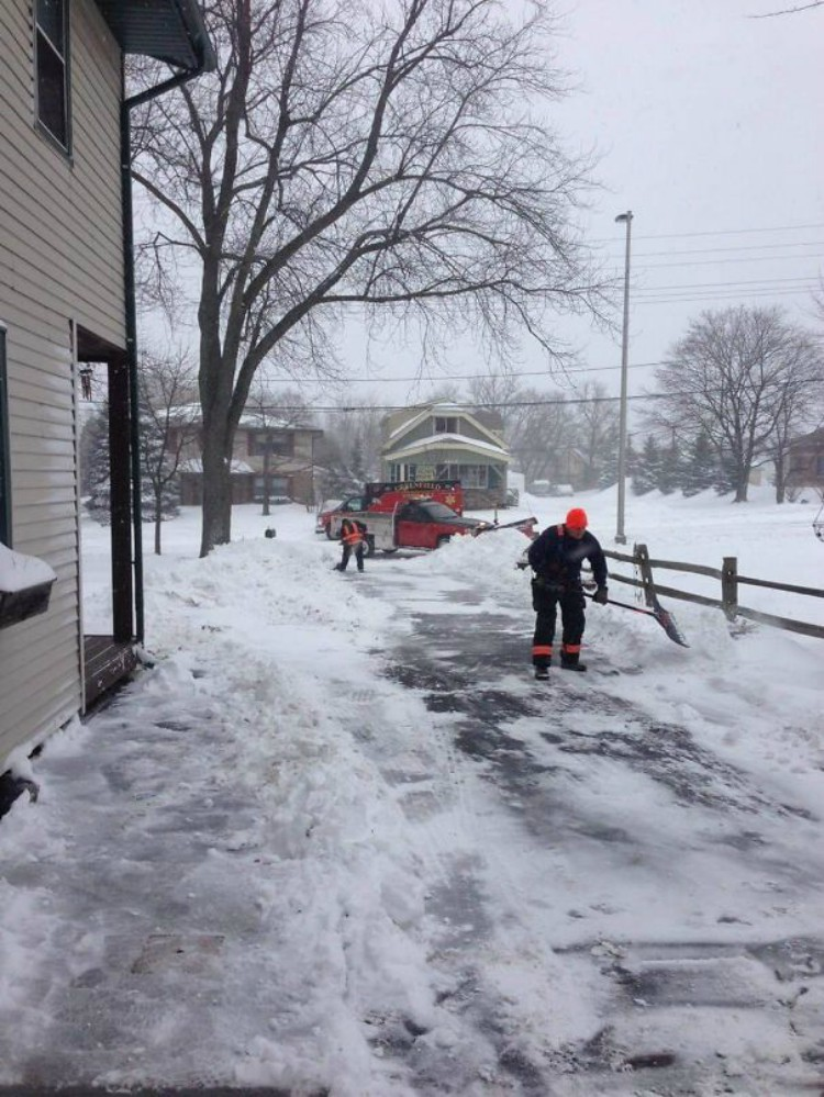 Image of man shoveling snow in driveway