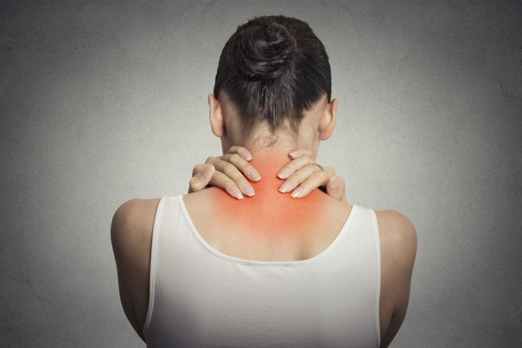 Image of woman holding neck in pain