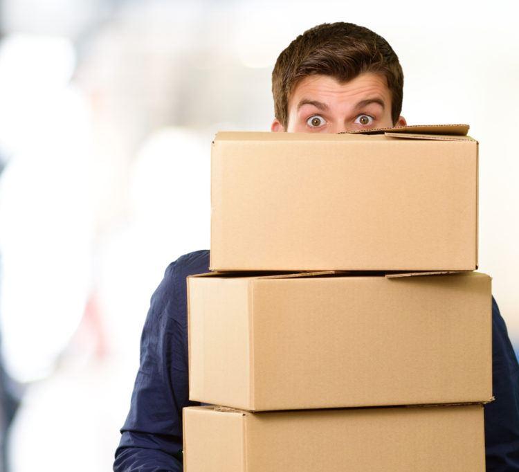 Man holding cardboard boxes.