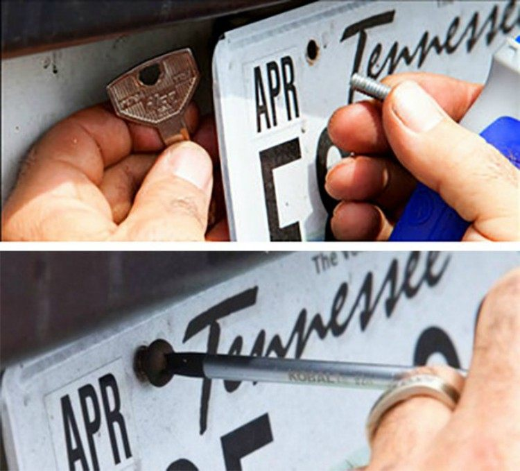 Screwing key behind license plate.