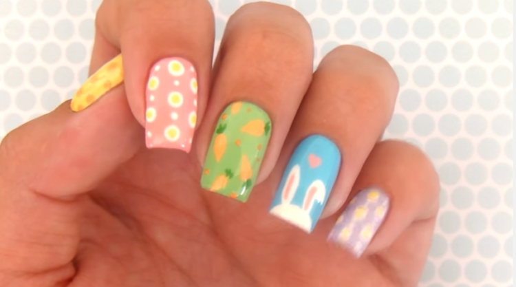 Fingernails painted with 4 different Easter designs