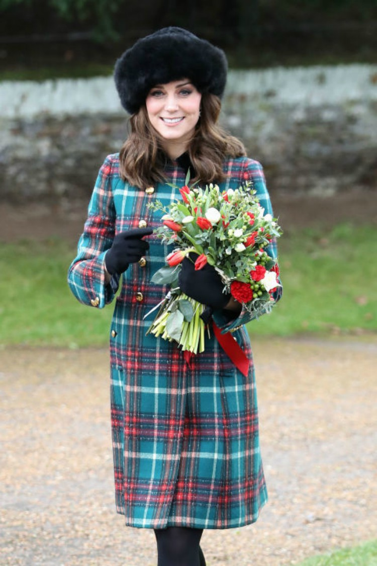 Image of Kate Middleton in festive plaid coat.