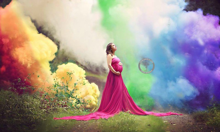 Image of pregnant mom with full rainbow smoke cloud.