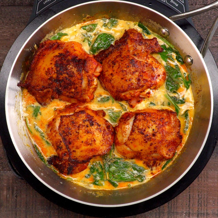 Tender, crispy chicken thighs and plenty of greens browned in a luscious paprika-infused lemon butter cream sauce that you'll want to pour all over everything.