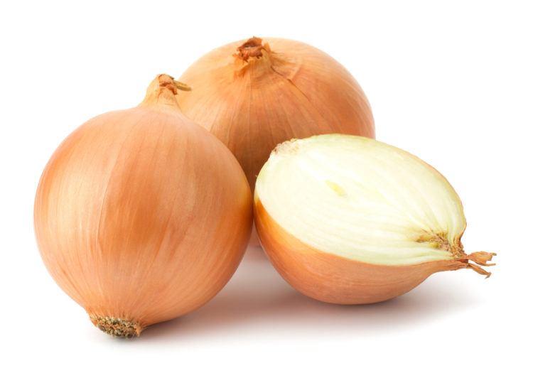 Yellow onion bulbs cut in half.