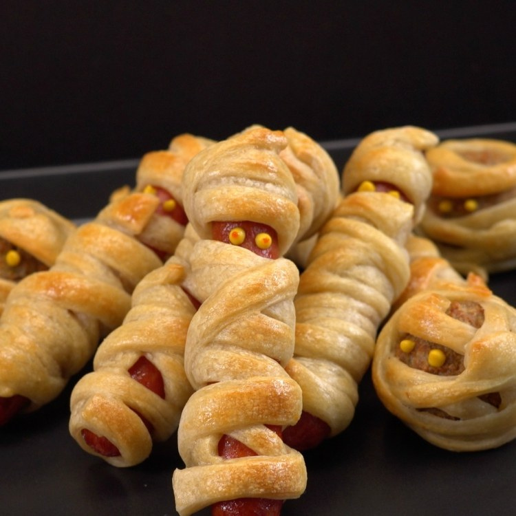 Hot dogs and meatball wrapped in dough to look like mummies