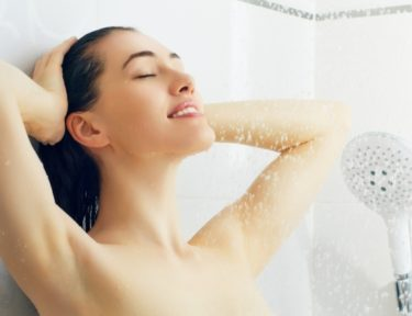 Image of a beautiful girl standing at the shower