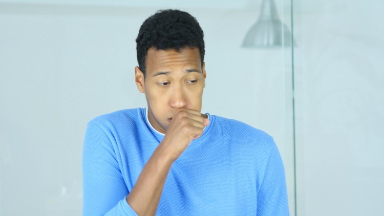 Image of male coughing.