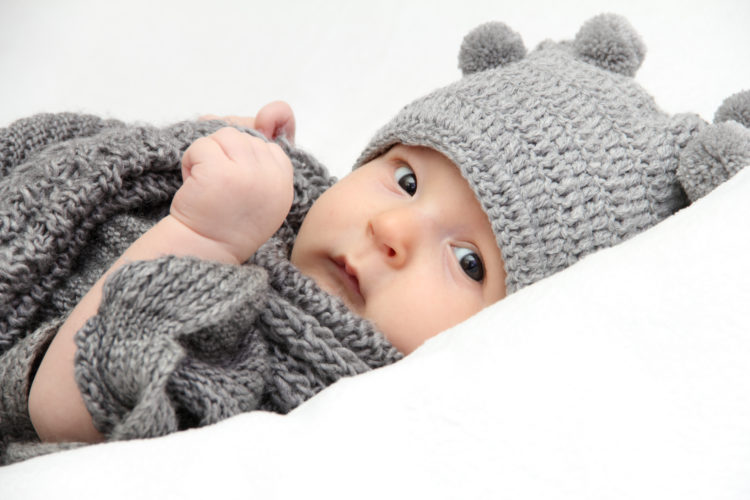 Image of Beautiful baby in gray knitted hat
