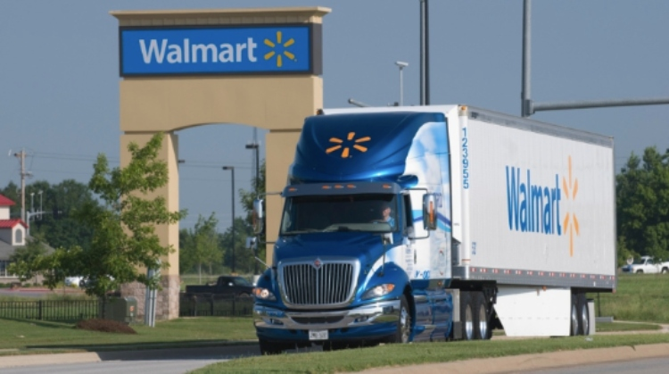 walmart truck drives down road