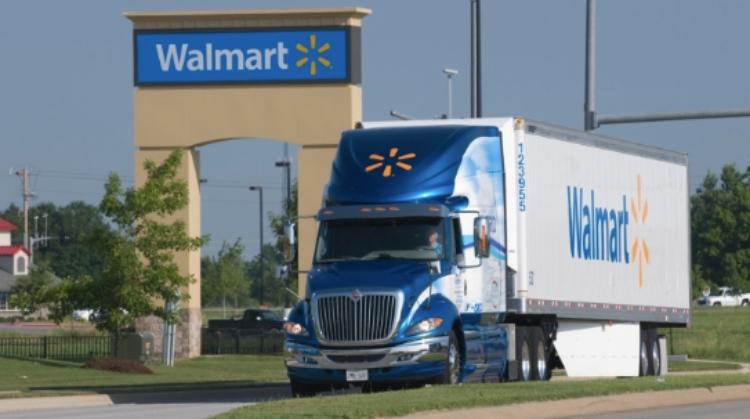 walmart truck drives down road