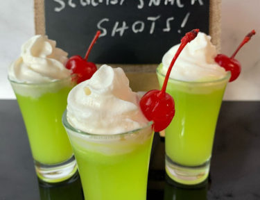 Scooby Snack Shot with Whipped Cream and Cherry
