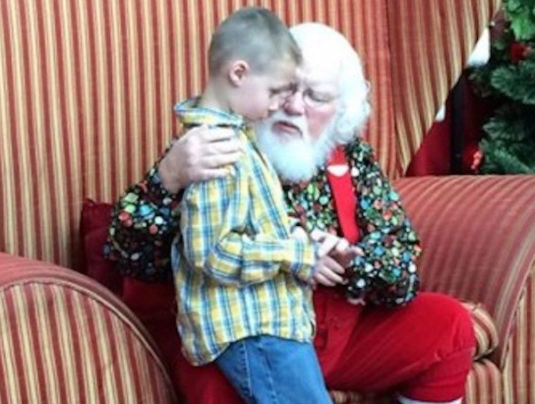 Landon sits with Santa.