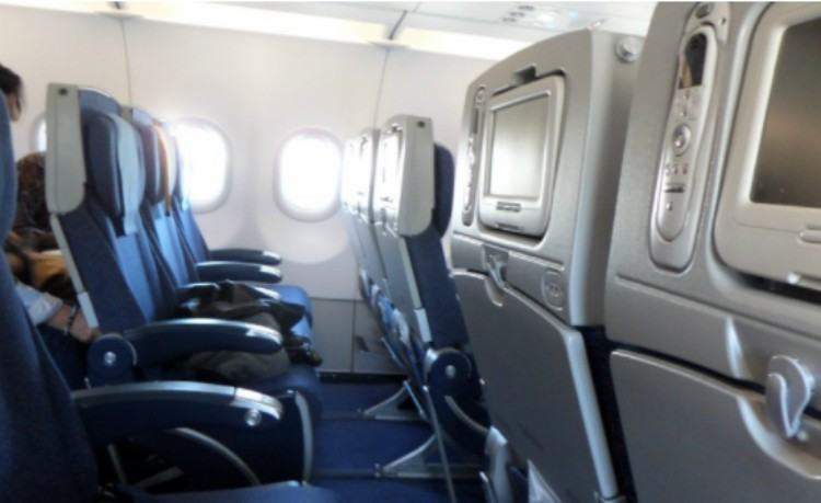 view of airplane cabin seats