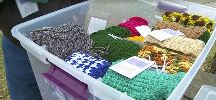 Image of bin of scarves.