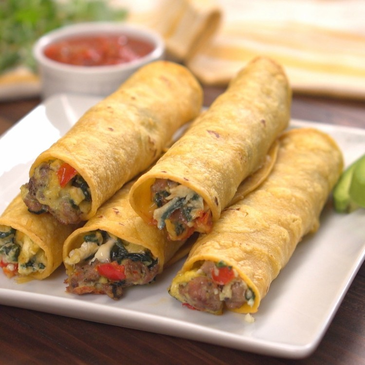 Stack of sausage, egg and cheese breakfast taquitos
