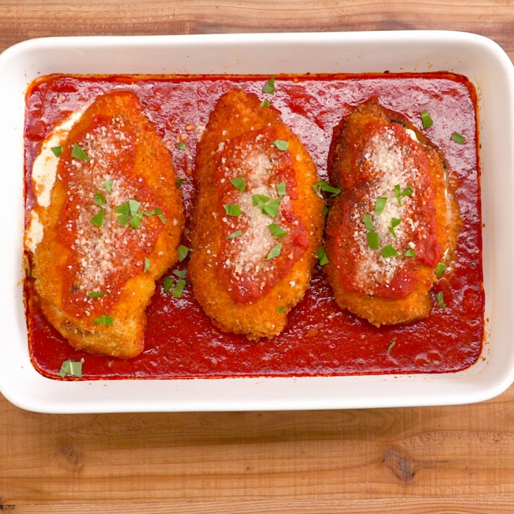 Chicken Parmesan stuffed with mozzarella, sun-dried tomatoes and basil