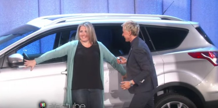 Mary hugs her new Ford Escape as Ellen watches