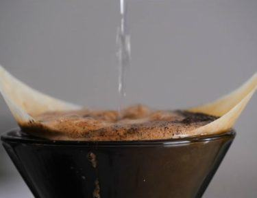 Image of coffee grounds in strainer.