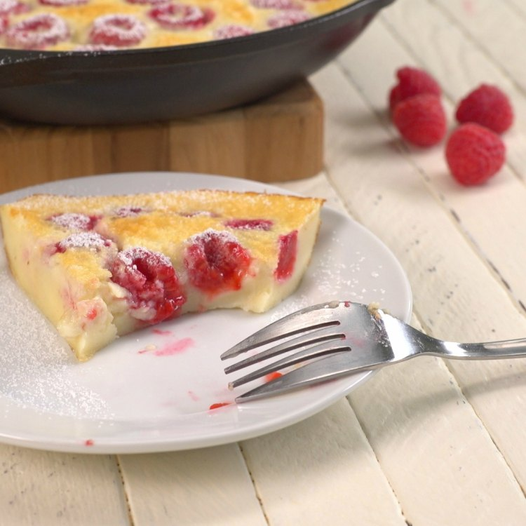 Piece of raspberry clafoutis that's been eaten